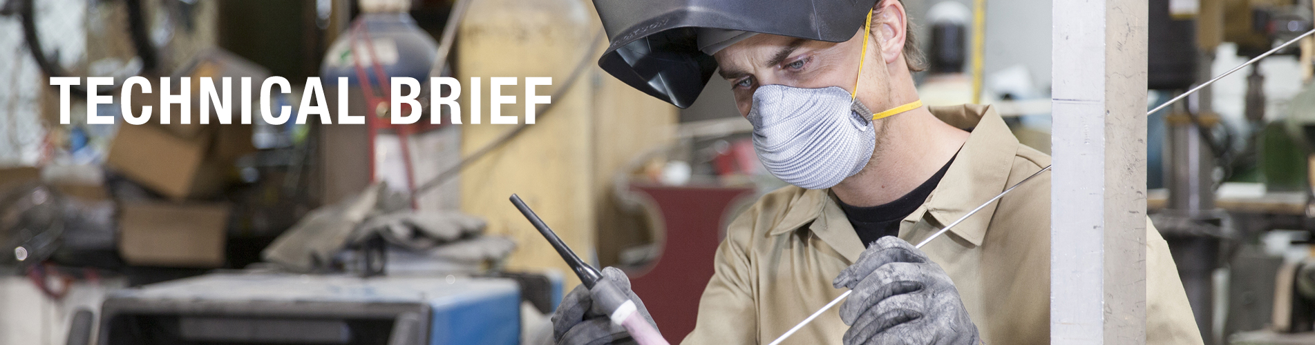 welder wearing fully disposable respiratory face mask in work area