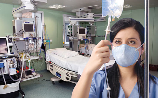 female nurse in face mask checking IV fluids in hospital room